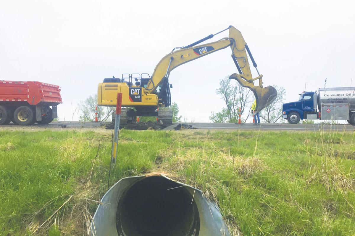 Crews tackle big highway hole, pipe | Local News | atchisonglobenow com