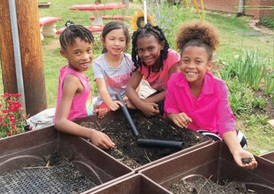 Cary Woods students work in the gardens at school