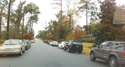 Cars parked along Terrace Acres Drive Monday morning