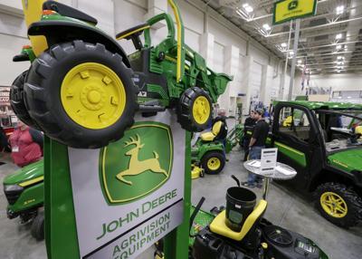 Flooding, trade war dim Deere's outlook again | Business