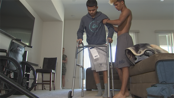 Higley HS JV football player released from hospital, now re-learning how to walk
