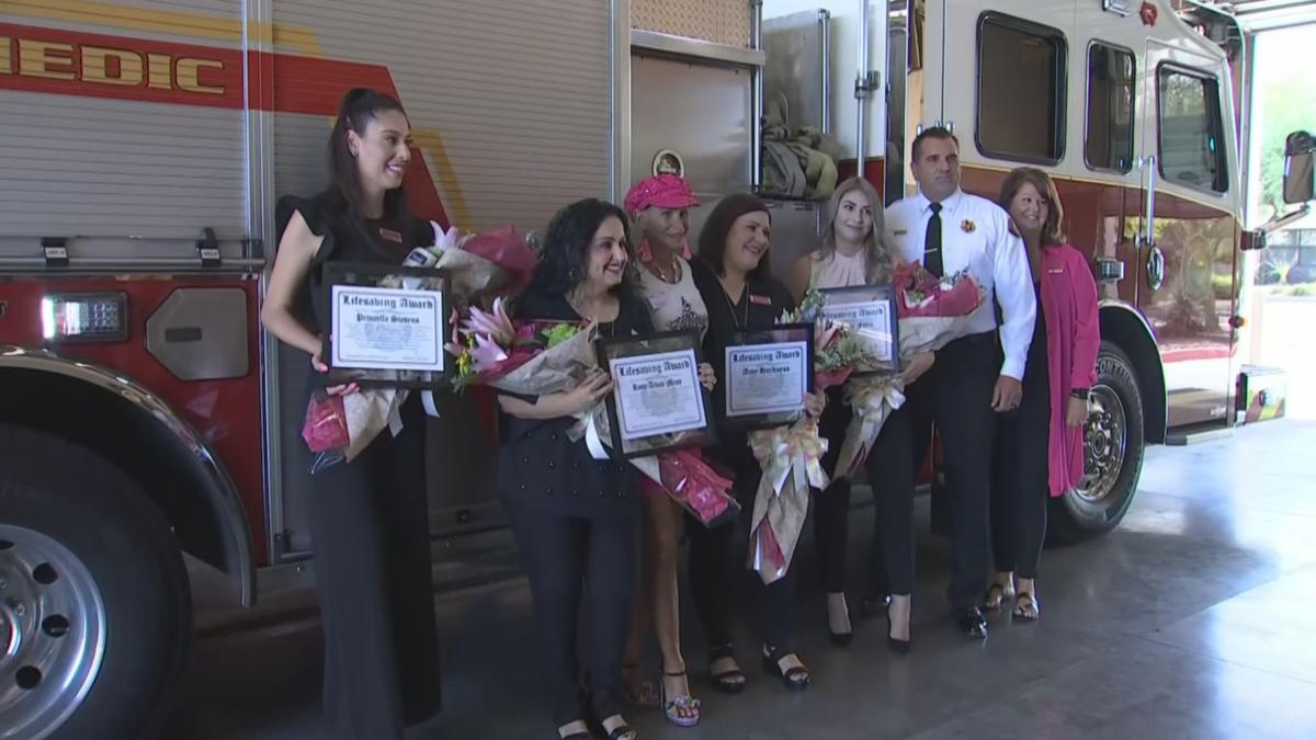 Macy's employees honored by Peoria Fire and Medical