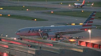 Flight from Phoenix to London diverted to St. Louis due to unruly passenger, airline says