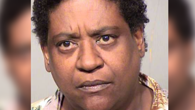 Lori Relf, 56, faces charges of aggravated assault with a deadly weapon, aggravated assault against an officer, and criminal damage.