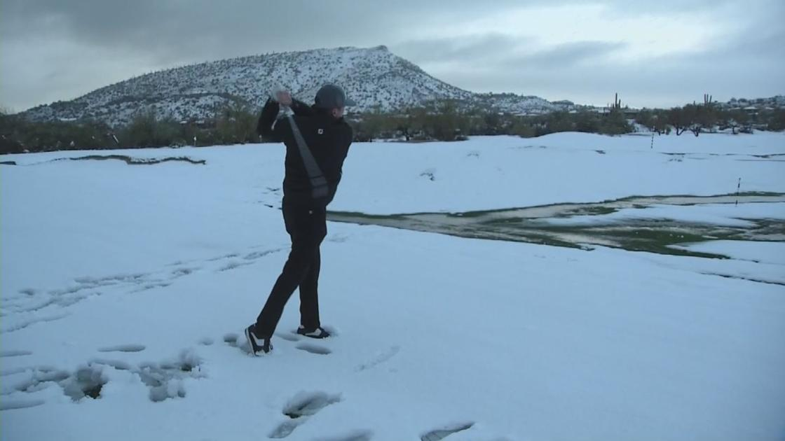 Professional golfers play at snow-covered club in north Scottsdale