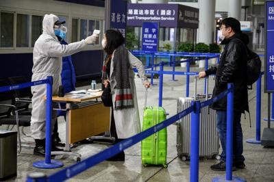 Hong Kong to quarantine all visitors from China as coronavirus death toll soars