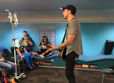 Country music singer Russell Dickerson performs for Phoenix Children's Hospital