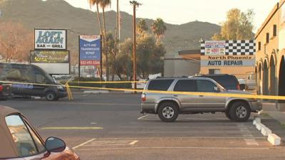 Man arrested, another man critical following shooting outside Phoenix bar