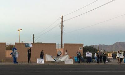 Activists rally outside Scottsdale aquarium after federal report on dolphin death