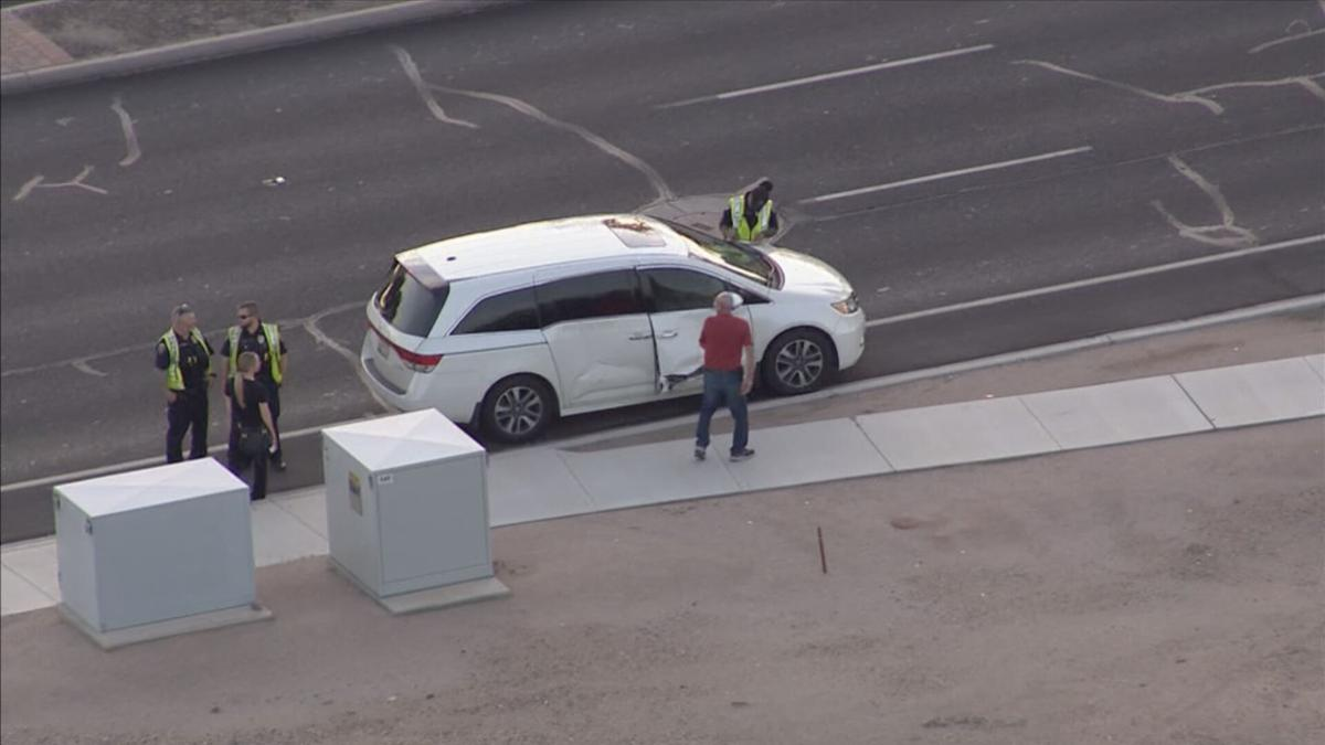 Vehicle hits light pole, then car in Chandler