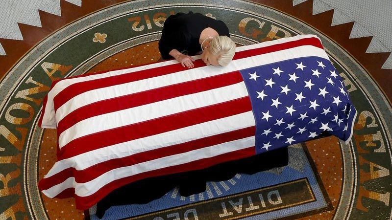 Sen. John McCain's family cries over flag-draped casket