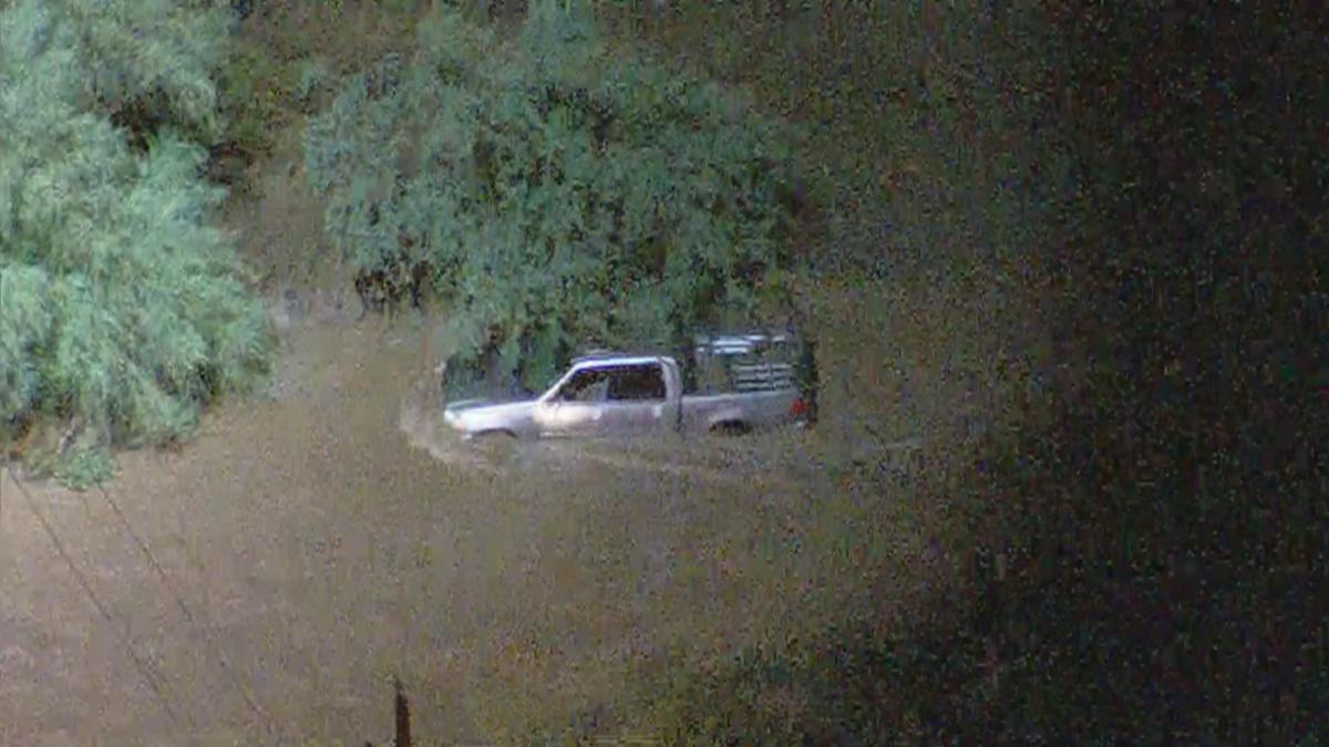 Emergency Crews Arrive At Flooded Area Near Anthem After Water