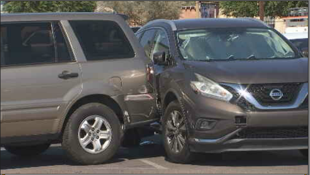 Multiple cars struck on private property in Phoenix by driver with child in car