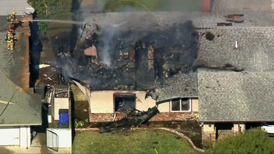 Pilot killed when plane crashes into California home; 3 people in house escape