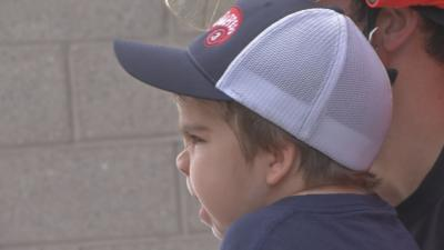 Little boy becomes honorary firefighter for the day