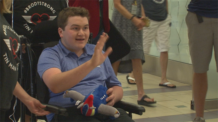 Emotional homecoming at airport for teen who was critically injured in August plane crash