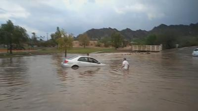 Phoenix family copes with waist-deep water during monsoon storm