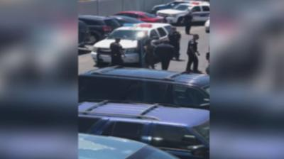 The video released Friday shows officers aiming guns and yelling profane commands at Dravon Ames and his pregnant fiancee, as she held their 1-year-old daughter.