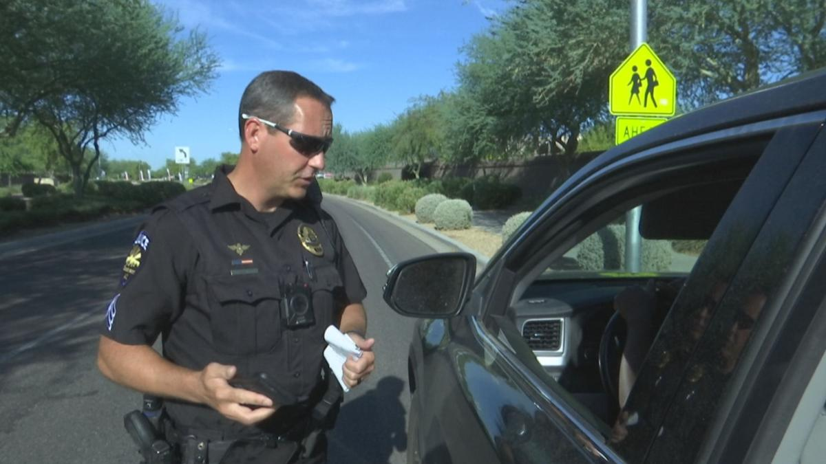 Goodyear police officer issuing a warning