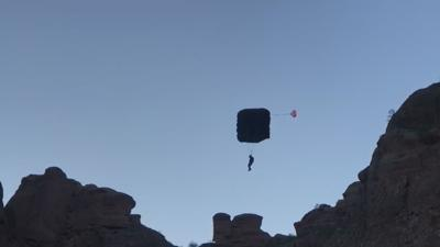 Marine veteran does 22 base jumps on Camelback Mountain for suicide awareness