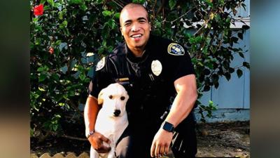 Cop adopts dog he found abandoned in stolen car
