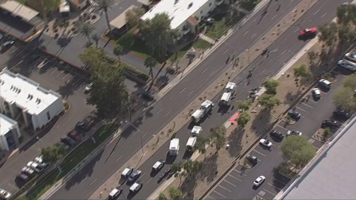 Truck crashes into Mesa building, second vehicle rolls (1).jpg