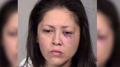 A Mesa woman has been arrested for allegedly attacking her boyfriend with a hammer on Christmas morning.