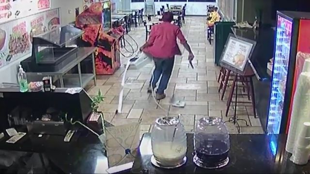 Armed robbery suspect caught on camera at Mexican restaurant