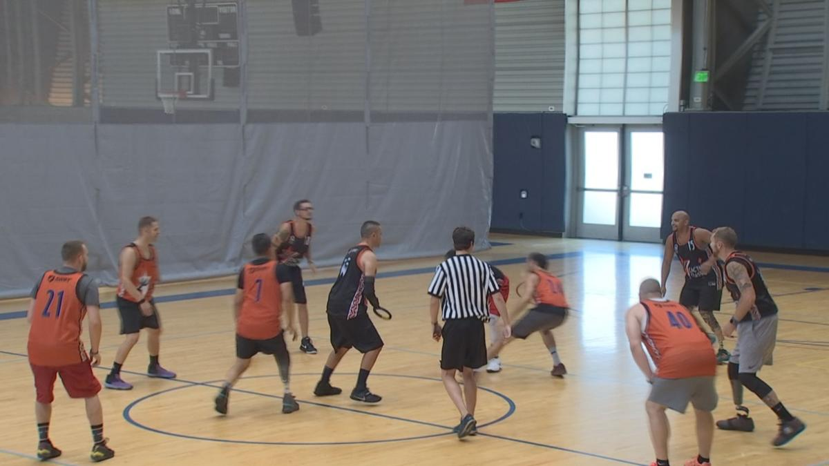 Missing limbs don't slow down amputee basketball players