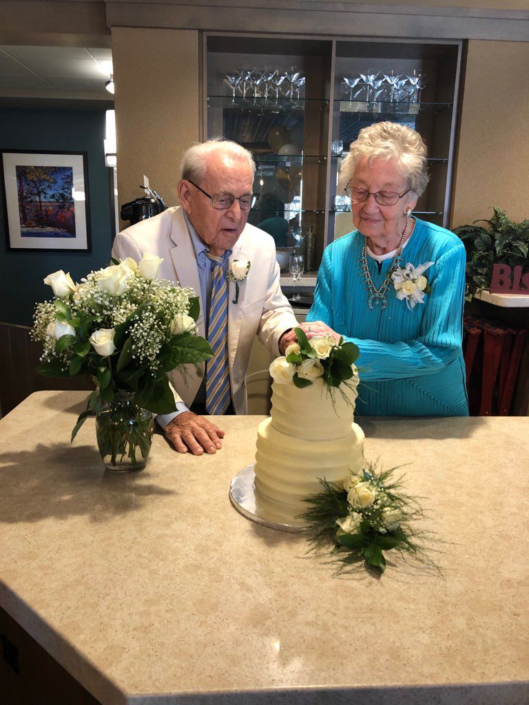 Pete and Mary Jo cut their wedding cake