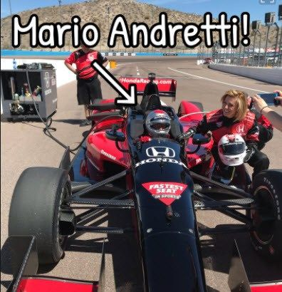 Kris Pickel takes a spin with Mario Andretti