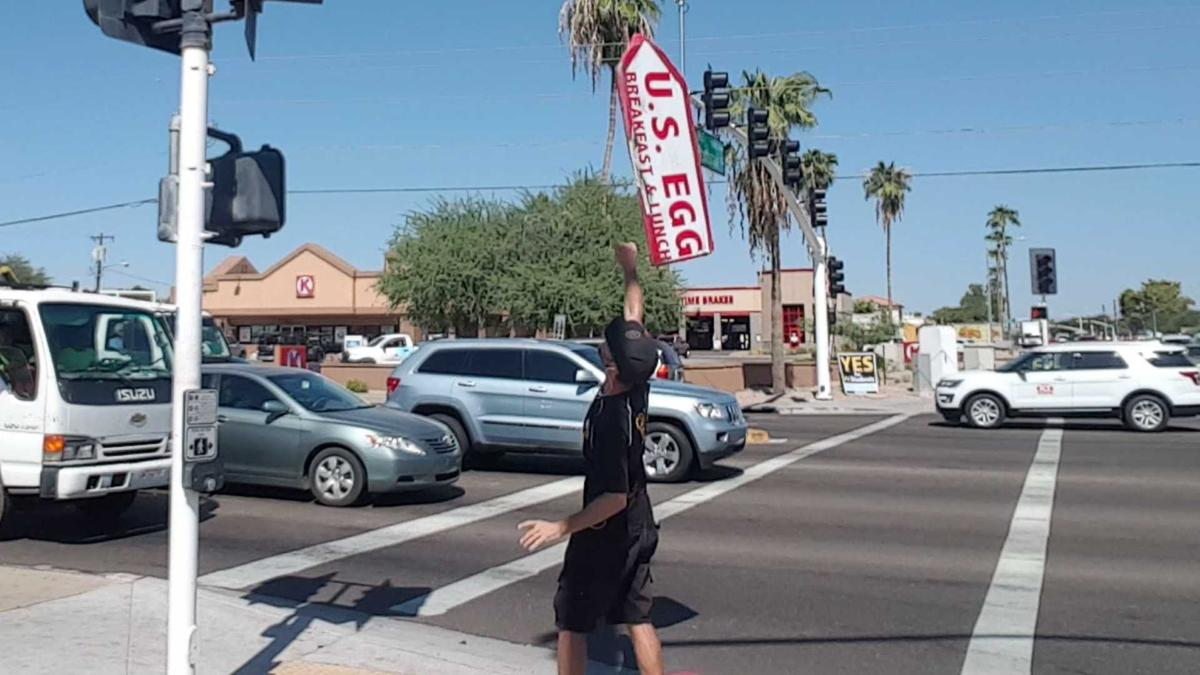 Superstar sign spinner: 'I have a performer's personality'