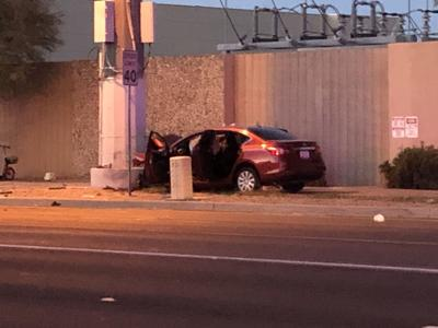 Man, woman rushed to hospital after car crashes into pole in Tempe