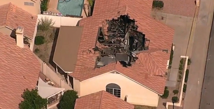 Human remains were discovered in this burned-out home in Ahwatukee