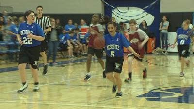 Classmates rally around special needs students at HS basketball game