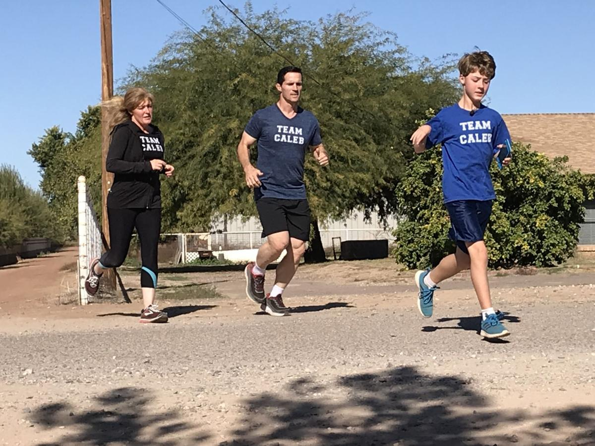 11-year-old Caleb Schroeder runs with his parents