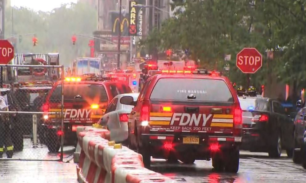 Helicopter crashes into building in New York City