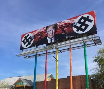 Billboard depicting Trump with mushroom clouds and swastika-like dollar signs pops up in Phoenix