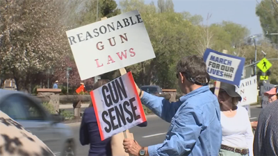 protesters line street outside nau where friends of nra dinner and