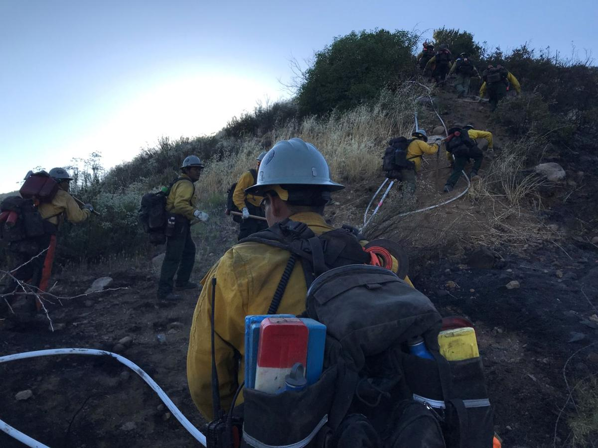 Fire fighter assigned to the Slate Fire Saturday