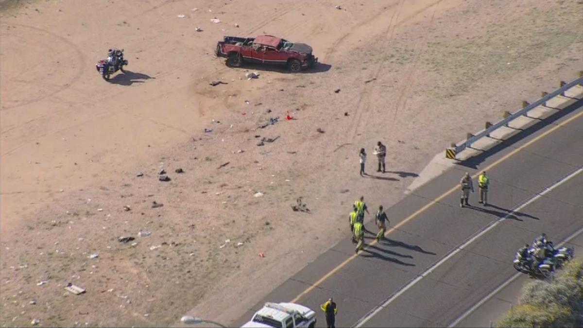 A red pickup truck was involved in an accident near the Loop 202