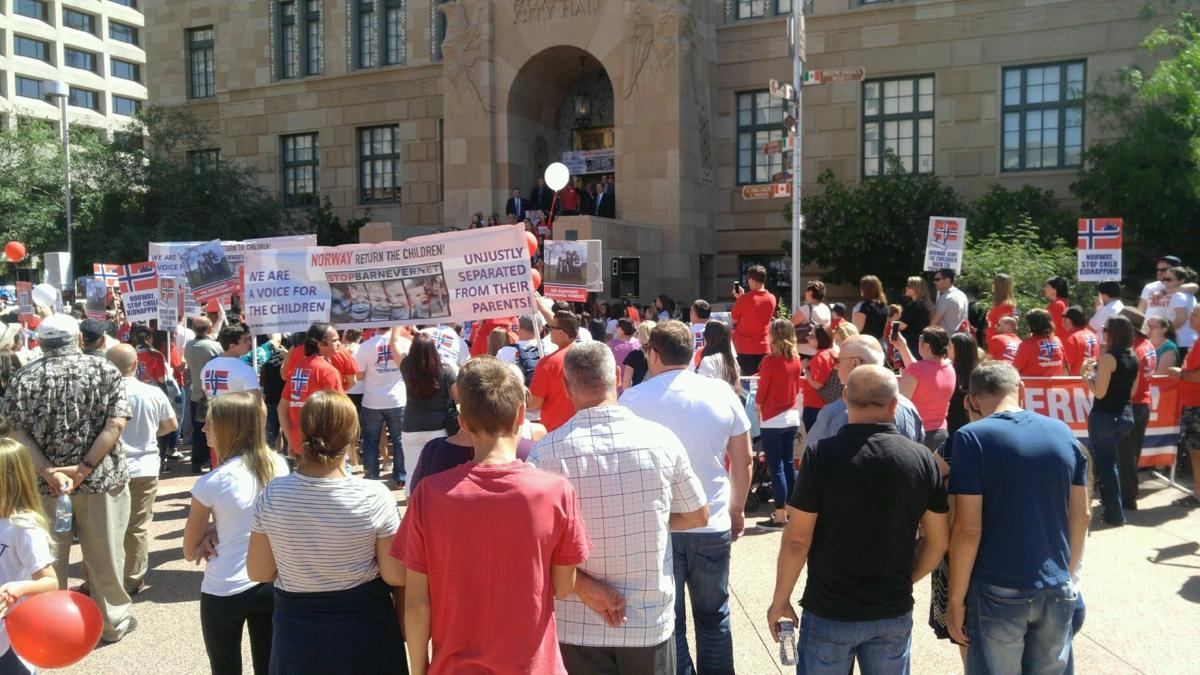 Marchers hold rally in downtown Phoenix in support of Romanian family