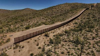 Construction company building private wall for group with Trump ties wins government contract