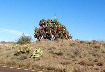 Santa's helpers decorate the 'mystery tree' on I-17
