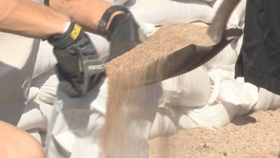 Tempe Fire and Rescue crews were on hand to help people fill and load sandbags into their cars