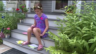 Girl receives national recognition after leaving coolers for mail carriers in the heat