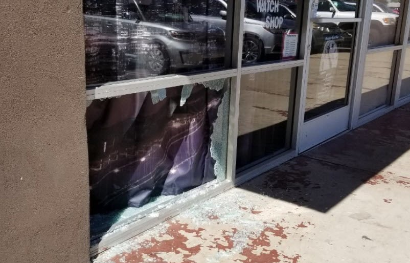 The thief smashed a window to get into the small shop