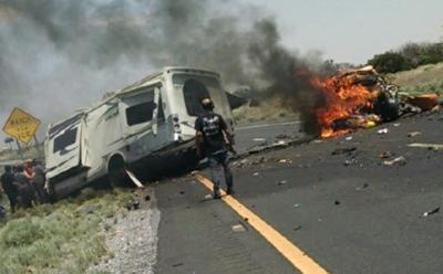 DPS said an orange Kia traveling westbound in the eastbound lanes collided head-on with an RV