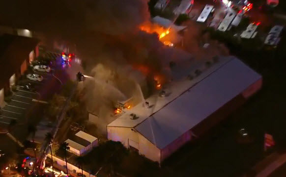 Our chopper was overhead as we watched the huge fire  shot flames and smoke into the air.