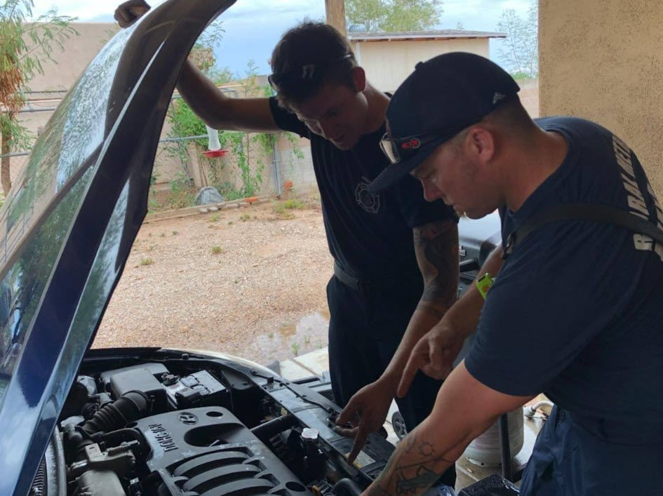 Crews had to cut through three belts and disassemble parts of the engine components to free the frightened feline.